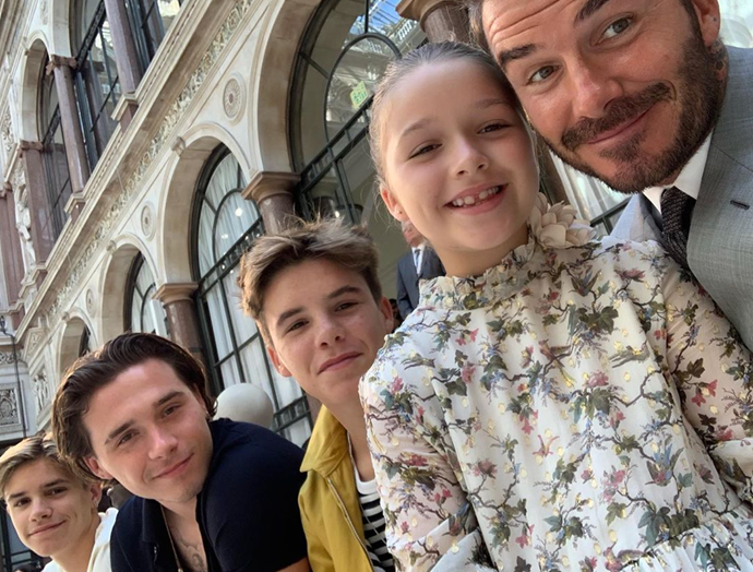 David and the kids are always sitting front row at Victoria's fashion shows.
