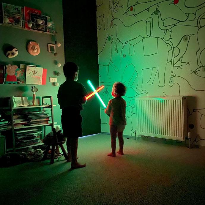 Playing around with lightsabers at home.