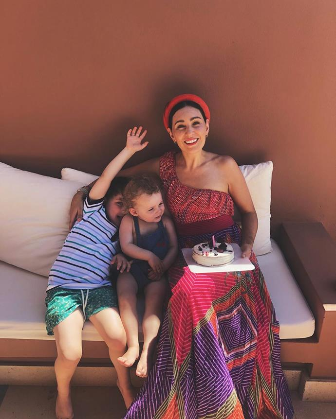 Birthdays are always better when they're spent overseas, in a fabulous dress and with cake! Zoe posted this cute snap of her clan while in Europe last year.