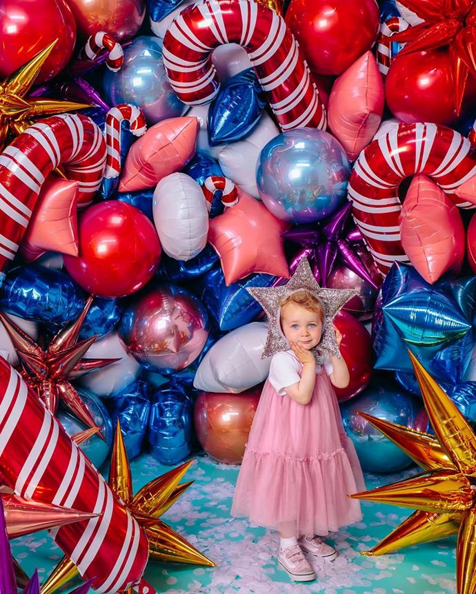 Little Rudy posed among this glorious wall of balloons at Christmas time last year.