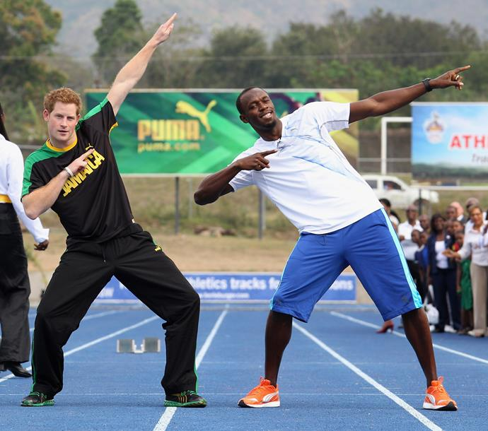 Okay, so *maybe* Usain went a little easy on the prince, but that didn't stop them from striking his iconic pose to finish it off.