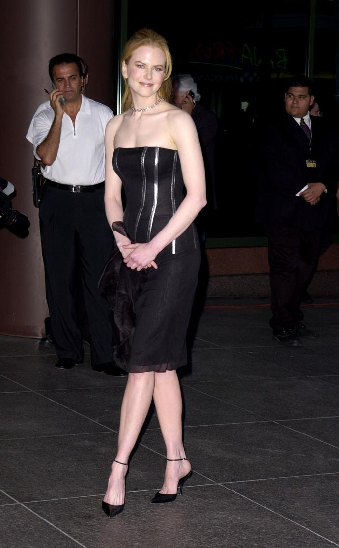 Aussie national treasure Nicole Kidman donned a form-fitting black dress following her divorce from Tom Cruise at the 2001 LA premiere of *The Hours*.