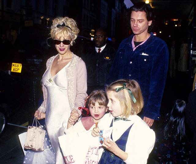 A pregnant Paula Yates and Michael Hutchence with Pixie and Peaches in London, just a few months before Tiger Lily's arrival.
