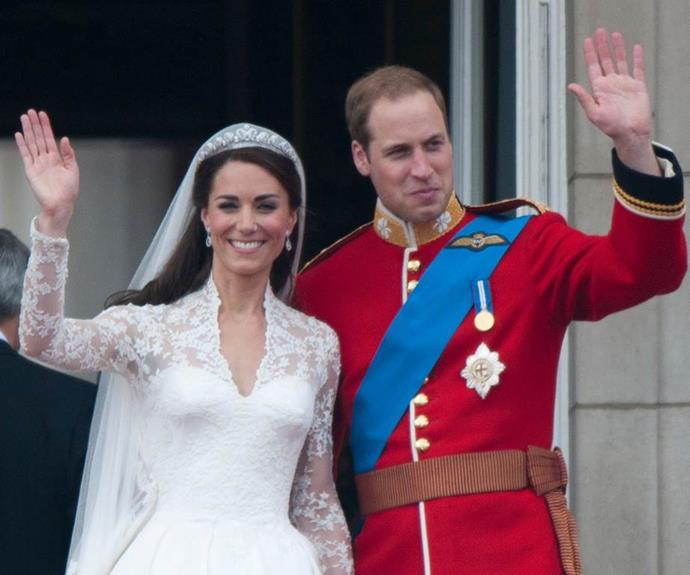 The Duke and Duchess of Cambridge wave to the crowds on their wedding day.