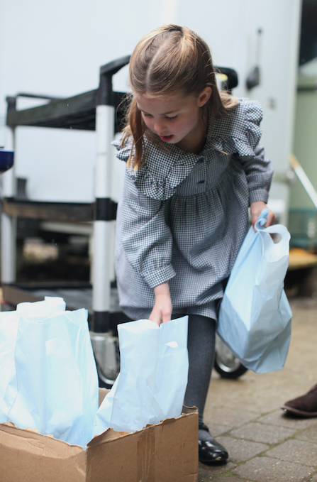 Charlotte is seen packaging up food for locals around the Sandringham Estate.