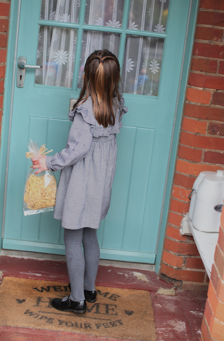 And off sh goes! The young Princess knocks on the door of an unsuspecting local.