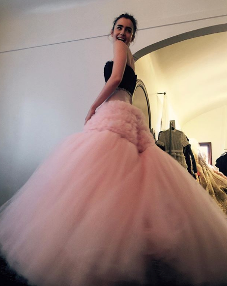 "The heavenly Lily Collins shared a series of images in retrospect as May 4 approached this year. She wrote: ""Met Ball Monday countdown. Things are a little different this year, so I'm getting nostalgic! Looking through my phone and found this picture... on Cloud 9 in my @giambattistavalliparis at the Met Ball fitting for Rei Kawakubo/ Commes des Garçons..."""