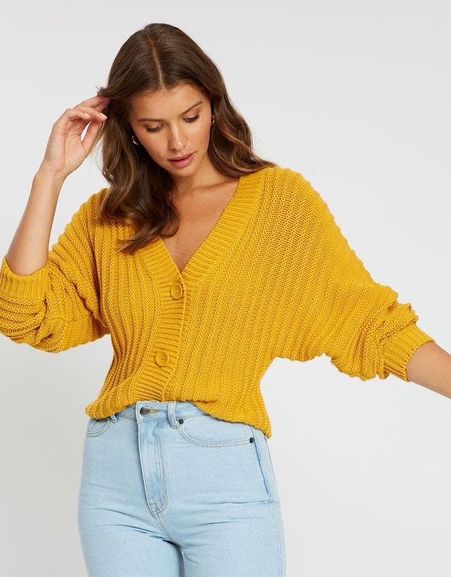 """A splash of mustard doesn't only spice up your meals. Add some colour to your winter palette with this Atmos&Here design. $69.99, [buy it online here](https://www.theiconic.com.au/skyla-ribbed-button-knit-cardi-943522.html