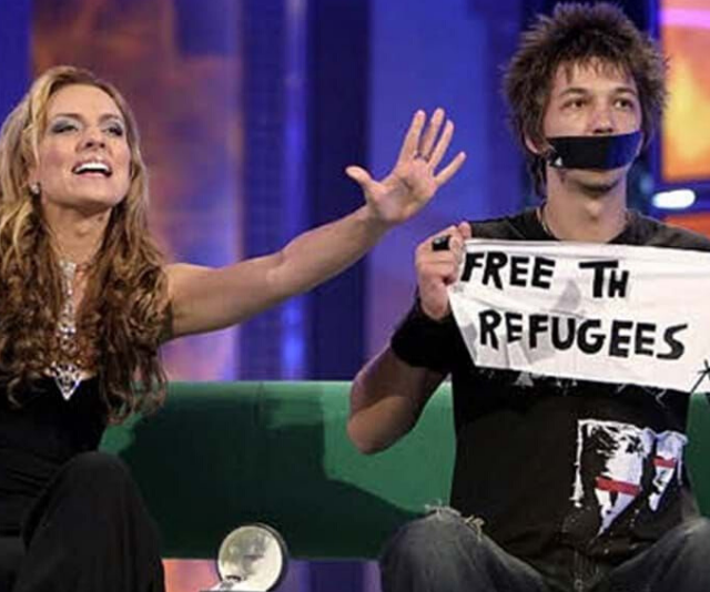 """**POLITICAL PROTEST** <br><br>  It was a moment of live television gold when 2004 housemate Merlin used his eviction to protest the mandatory detention of asylum seekers in Australia. Upon exiting the house, Merlin taped his mouth with gaffer tape and held up a sign reading, """"Free The Refugees,"""" forcing host Gretel into a tight spot as she tried to calm an aggravated crowd and strong-minded Merlin, who refused to speak to her. Speaking of the moment years later, Merlin revealed he had sewn his sign into the lining of a T-shirt to ensure it wasn't removed by producers."""