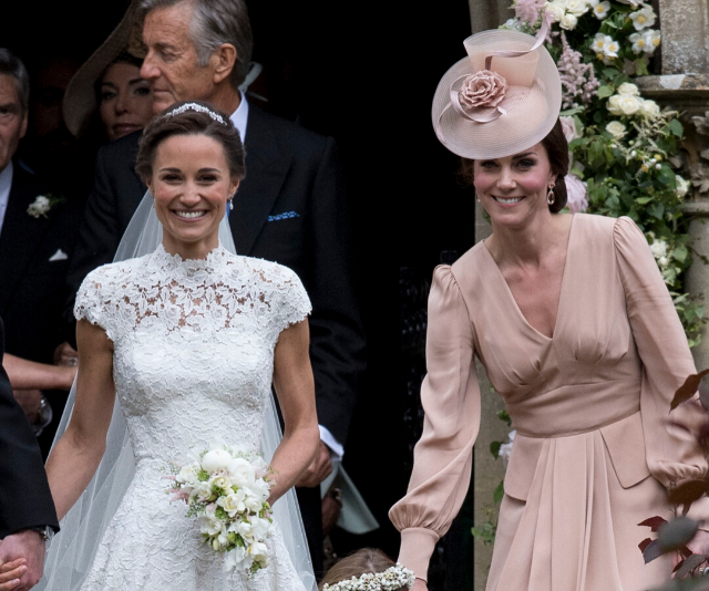 Kate helped out her sister on her big day. Side note - how amazing do Pippa biceps and triceps look here?