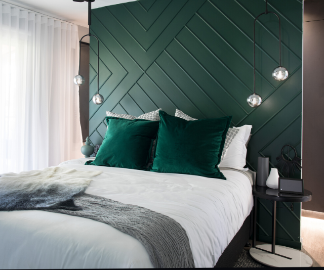 """I do like to be wowed,"" Kyly exclaimed as she entered Lenore and Bradley's freshly renovated master bedroom, to which Saul agreed. The feature wall doubling as a bed head was a statement piece that won over all three judges."