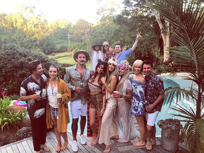 The pair rang in the new year in Byron Bay with friends at a fun dress up party. You can spot Delta in the front row with her girlfriends and Matthew in the back.