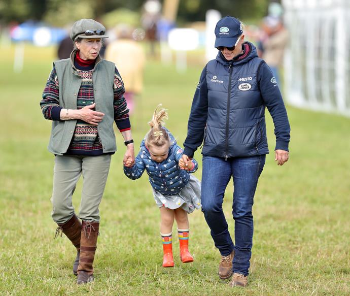 Who didn't play this game with their parents and grandparents back in the day? Mia goes in for the swing as Zara and grandma Princess Anne hold tight during a fete.