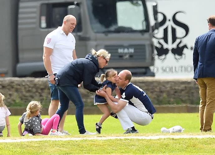 Family fun at the polo is the name of the game for the royal family. Prince William gets a quick cuddle from his second cousin Mia mid-match in 2017.