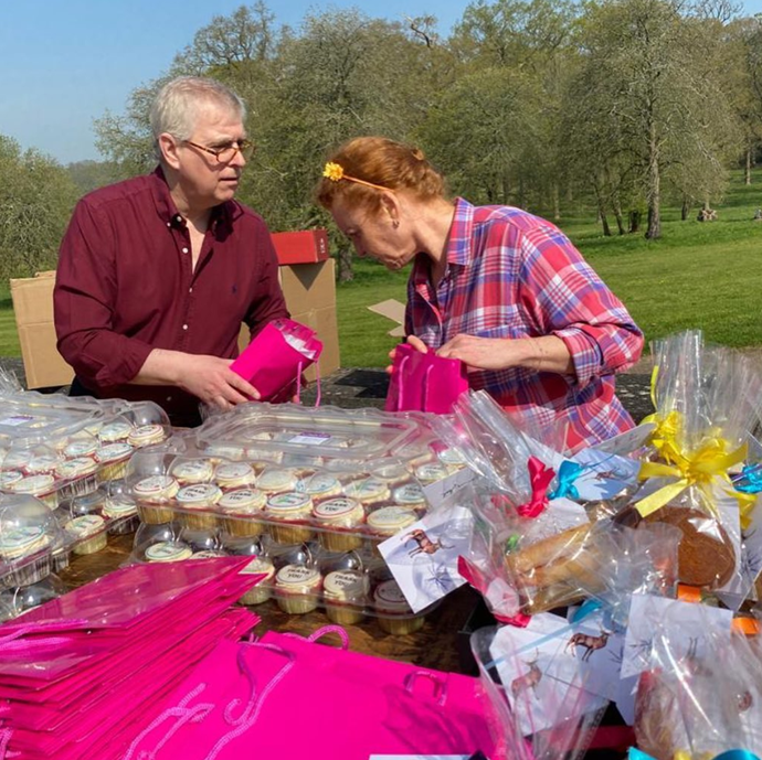 Prince Andrew and Sarah Ferguson assemble care packages together.