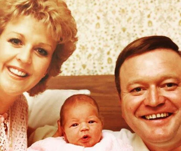 The showbiz couple with their newborn daughter Lauren in 1979.