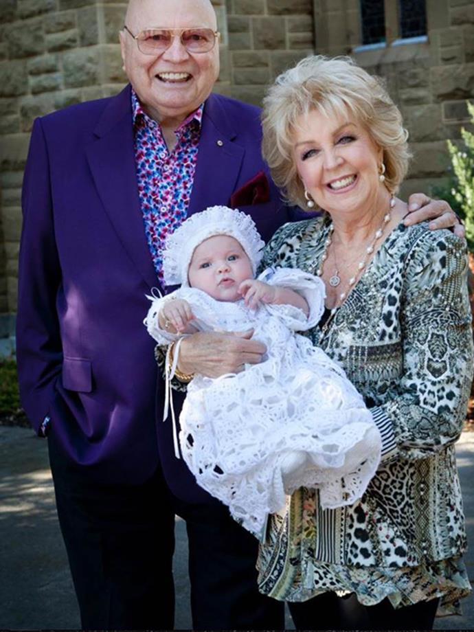 Proud grandparents Bert and Patti with granddaughter Perla at her christening.
