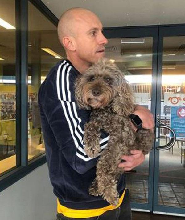 The last goodbye: Fitzy cuddles his dog Cooper one final time.