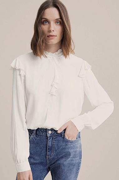 "This feminine frill blouse from Witchery can be dressed down with jeans or up with ponte pants. $99.95, [buy it online here](https://www.witchery.com.au/shop/clothing/shirts/60255698/Frill-Button-Through-Blouse.html|target=""_blank""
