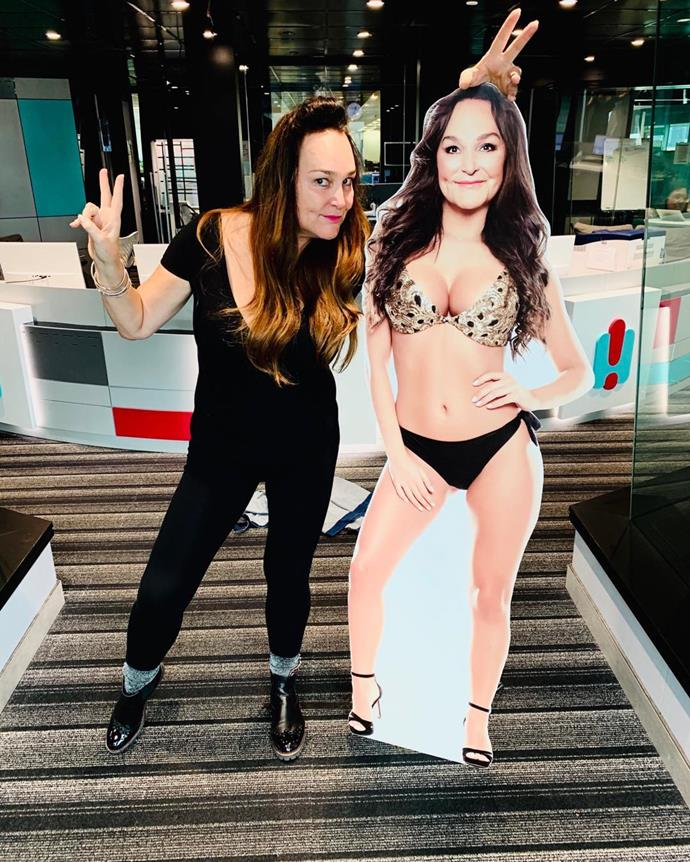 Kate posing with a bikini cut out of herself.