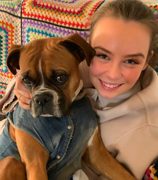 """""""My two favourite girls in the world... @billifitz and our beautiful disabled, mischievous heartbreaker, @maggie_boxerdog. Inseparable. Happy International Dog Day!"""" Lisa captioned this cute snap."""