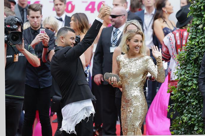 Waving to fans on the red carpet at the 2014 ARIA Awards.