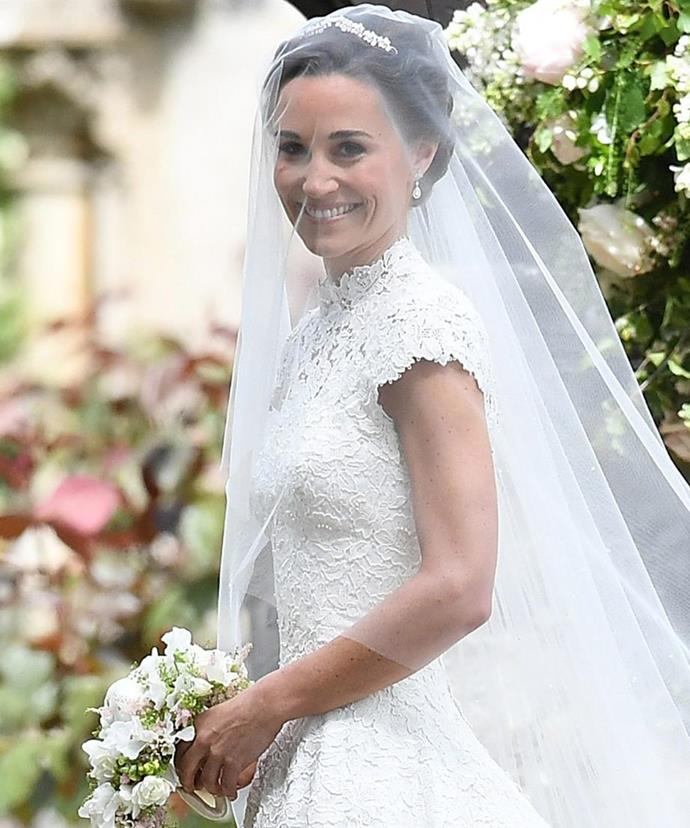 As expected, Pippa wowed in a stunning bridal gown by Giles Deacon. Featuring a beautiful lace bodice with short sleeves and a high neck, the most iconic bridesmaid of the early 2010s had finally become the bride - and boy was it worth the wait.