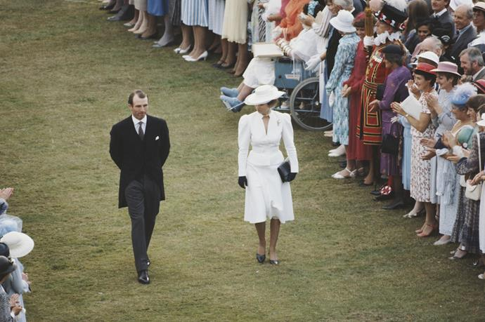 In 1985, Princess Anne donned her whites for the Queen's special garden event, opting for a chic puff-sleeved style. A synonymous silhouette of the times, to say the least.