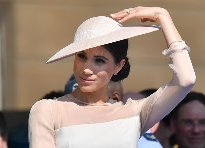 You certainly couldn't fault her flawlessly angled hat and blush dress, designed by London-based label GOAT.