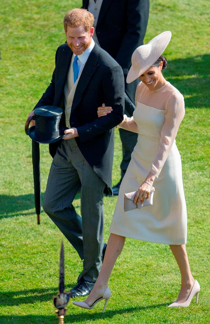 Newly married and ready for some right royal action, Prince Harry and Duchess Meghan beamed as they arrived at the Queen's garden party in 2018. Already, Meghan had cemented herself as a royal fashion icon.