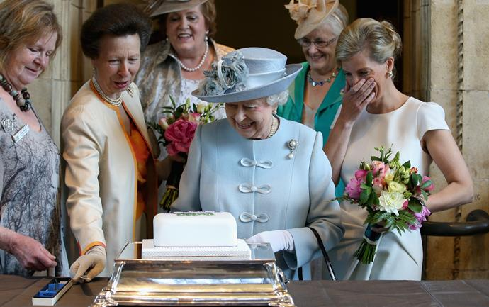 As she attended a women's meeting with the Queen in 2015, Sophie couldn't hold back the giggles as she and Princess Anne helped her cut a cake.
