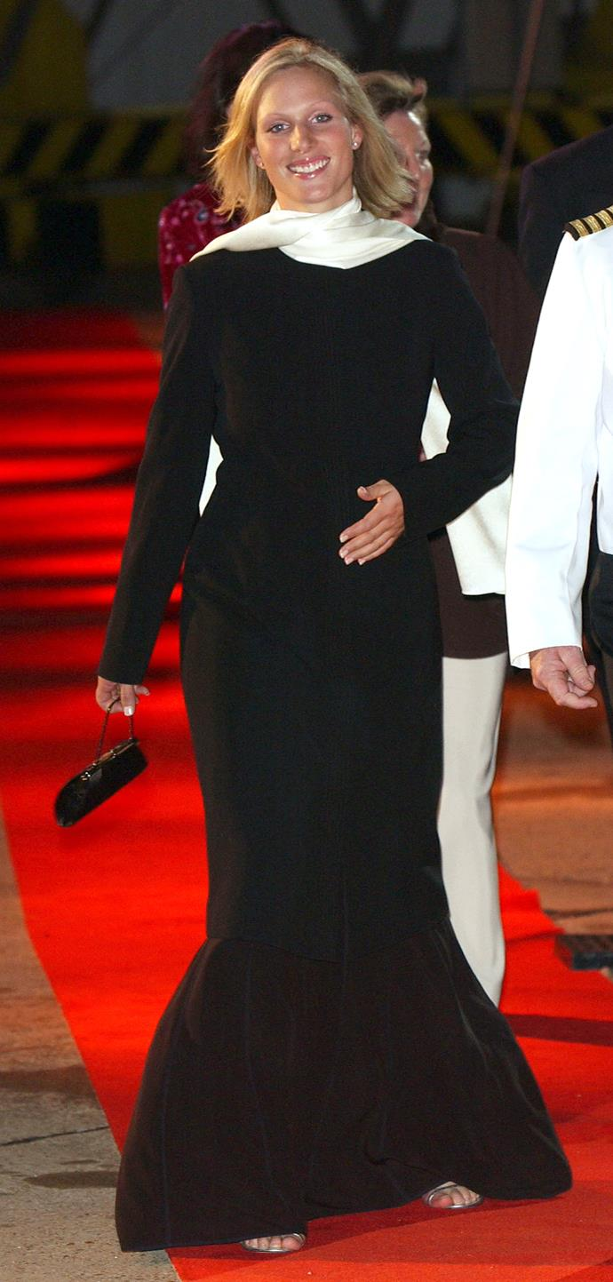 "In 2003, Zara literally glowed in this [unique long-sleeved gown](https://www.nowtolove.com.au/royals/british-royal-family/zara-tindall-style-61924|target=""_blank"") with a flared hem while attending a cruise ship launch."