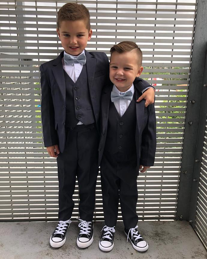 Hudson and Archie all dressed up in matching suits for a special event.