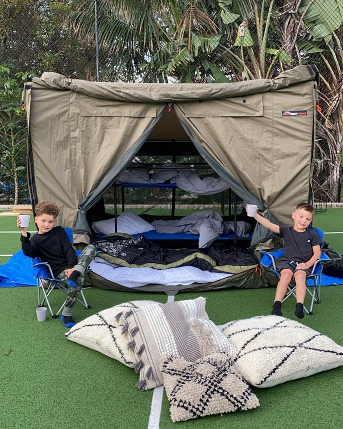 """When the COVID-19 pandemic put the family's campings plans on hold, Guy instead whipped up this camping set up in their backyard to make up for it.  <br><br> """"We had planned to take the boys camping this school holidays. But if this time has taught me anything it's that all the boys want is our TIME. Whether we were on a camp site or in our backyard they were so excited to be singing around the camp fire, toasting marshmallows and sleeping outdoors,"""" Jules wrote on Instagram alongside this cute photo."""