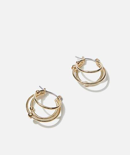"""A little hoop goes a long way - these Rubi stack earrings bring the perfect pop of gold to any outfit. $9.99, [buy them online here](https://cottonon.com/AU/luxe-layers-small-triple-stack-hoop/426618-01.html