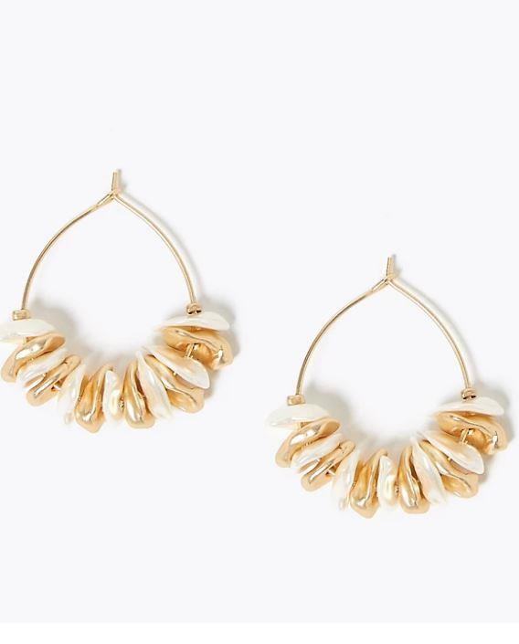 """If you're after something a little different, but not *too* far out of the box, these beautiful Marks & Spencer shell cluster earrings are a winner. $20.50, [buy them online here](https://www.marksandspencer.com/au/shell-cluster-hoop-earrings/p/P60443456.html