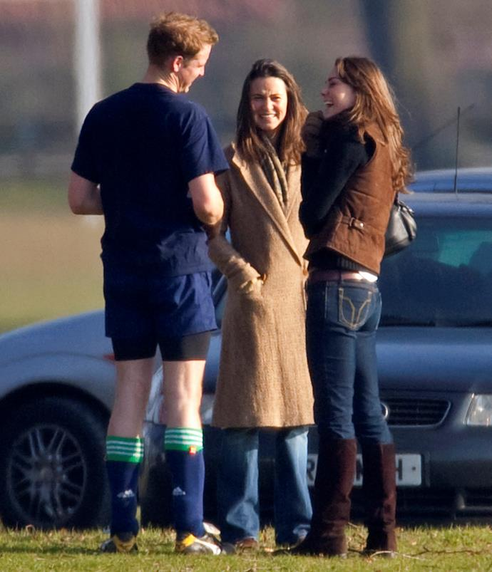 Pictured a few years into their courtship, Kate and her sister Pippa Middleton share a laugh with Wills at an Eton Old Boys soccer match in 2006.