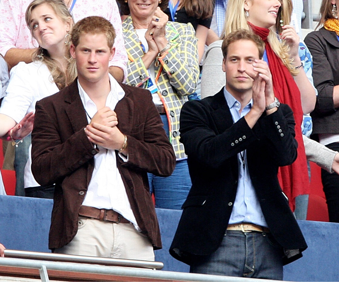 A young Prince Harry and Prince William cheer for performers during a charity concert celebrating their late mother Princess Diana in 2007.