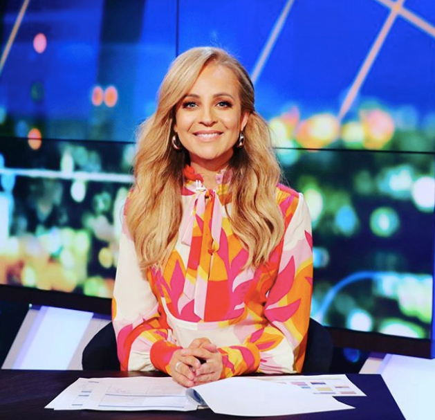 On Monday, May 25, Carrie went for the full palette in this bright funky Rebecca Valance blouse. She certainly made our screen's pop!