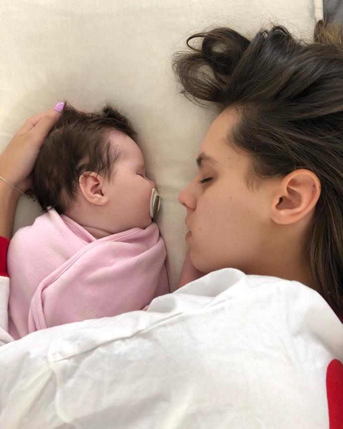 Mia and a very little Tobi enjoying those newborn sister snuggles.