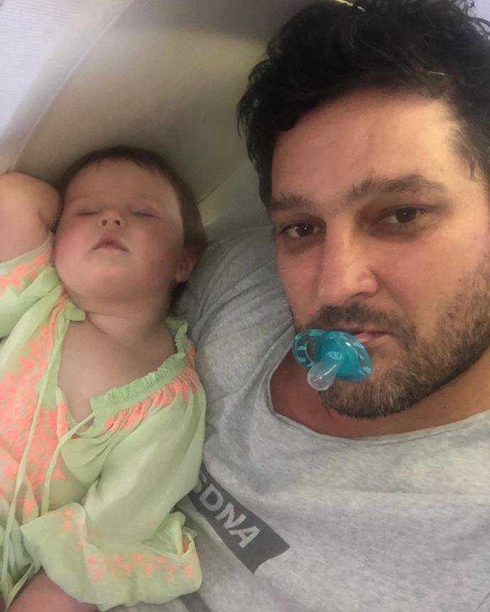 """When your bubba has had enough of holidays #outcold,"" Fev captioned this cute photo fo Tobi taking a much-needed nap."