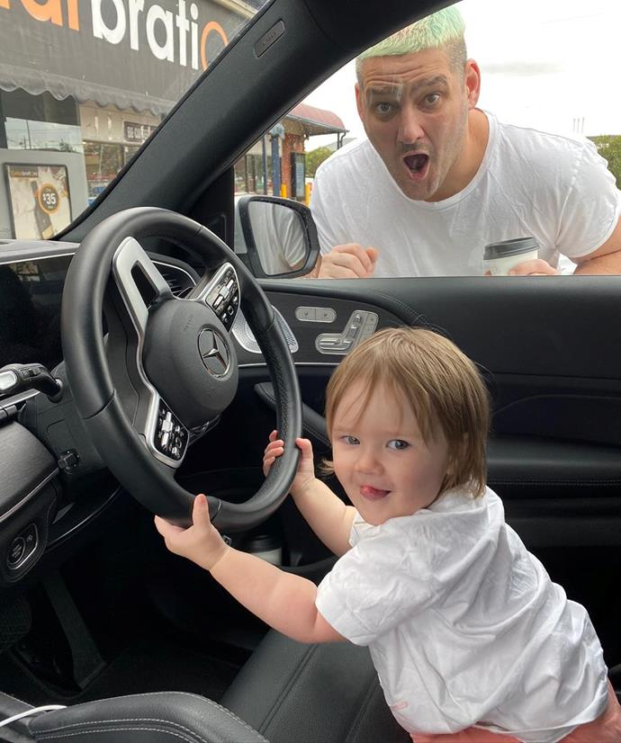 "Cheeky little Tobi was caught trying to drive her Dad's car. ""Sunday morning drives with at @tobifevola at the wheel,"" Fev captioned this snap."