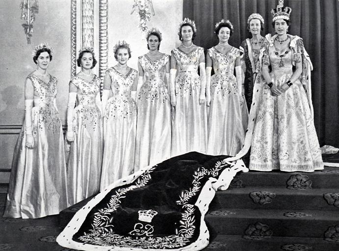 The incredible gown (pictured on the Queen above, as she stands next to her Coronation Bridesmaids) took months of work to complete.