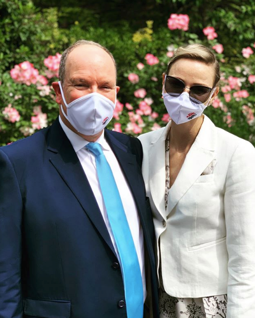 Charlene of Monaco and Prince Albert wore face masks featuring the Grimaldi family crest.
