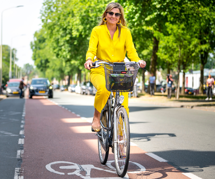 Máxima looked fabulous as she cycled to her appointment.