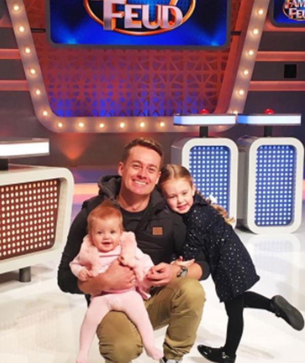 Bring your daughters to work day! Grant and his girls on the set of *Family Feud*.
