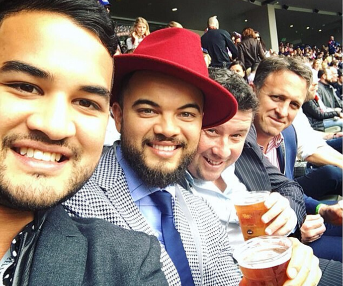 Guy having a beer with Titus (far right) and some mates at the footy, before their relationship turned sour.