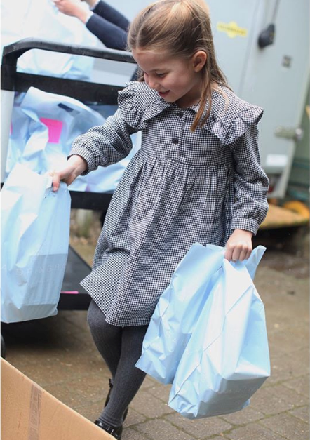 Back in May, the Palace released some beautiful shots of Princess Charlotte as she helped volunteer in the local community.