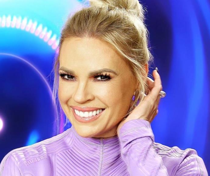 The presenter went all out for the *Big Brother* premiere night, opting for dramatic eyes, a nude-coloured lip and a high bun which put her stunning features on display.