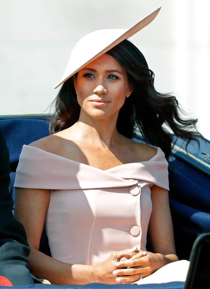 Duchess Meghan broke onto the Trooping the Colour scene with flying, well... *colours* in 2018. Mere weeks after her showstopping royal wedding to Prince Harry, Meghan's pastel pink Carolina Herrera dress became an icon in itself.